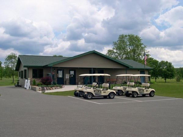 front of clubhouse with carts